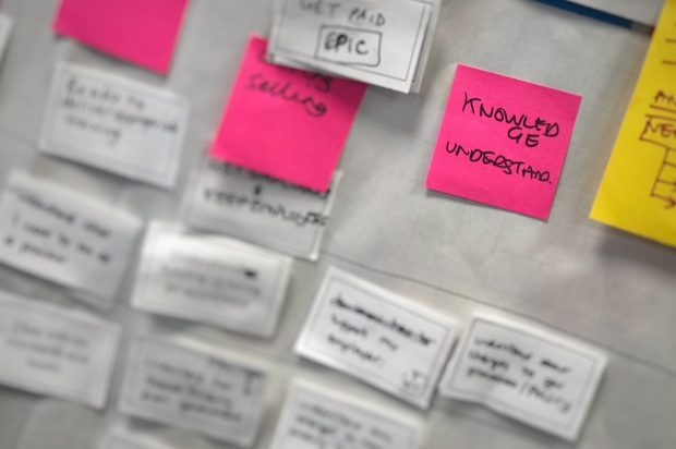 user research post-it notes zoomed in on one post-it - knowledge understanding
