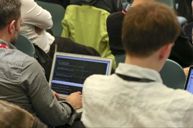Group of people participating at a coding hack day