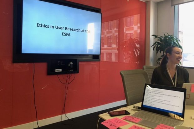 User researcher Lydia presenting a meeting on ethics in user research at the ESFA